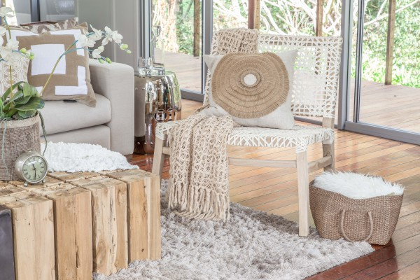 The Sweni occasional chair with white leather weave is ideal for elegant casual living.