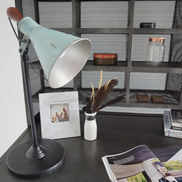 Industrial handcrafted table lamp in tarnished zinc and black metal.