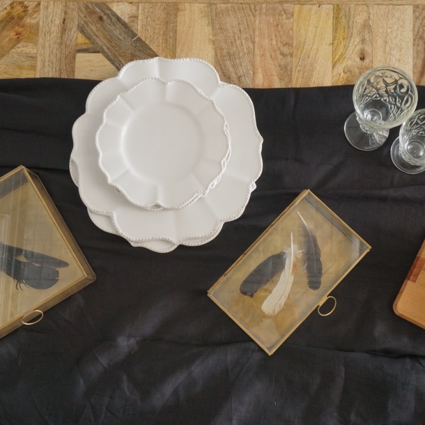 Collioure scalloped ceramic dinnerware and glass boxes have rustic charm.